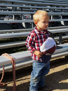 2 year old cowboy salutes the flag