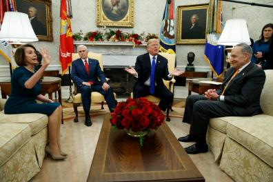 House Minority Leader Rep. Nancy Pelosi, D-Calif., Vice President Mike Pence, President Donald Trump, and Senate Minority Leader Chuck Schumer, D-N.Y., argue during a meeting in the Oval Office of the White House, Tuesday, Dec. 11, 2018, in Washington. (AP Photo/Evan Vucci)