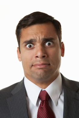 Hispanic businessman with surprised face