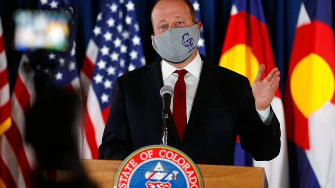 Jared Polis wearing a facemask